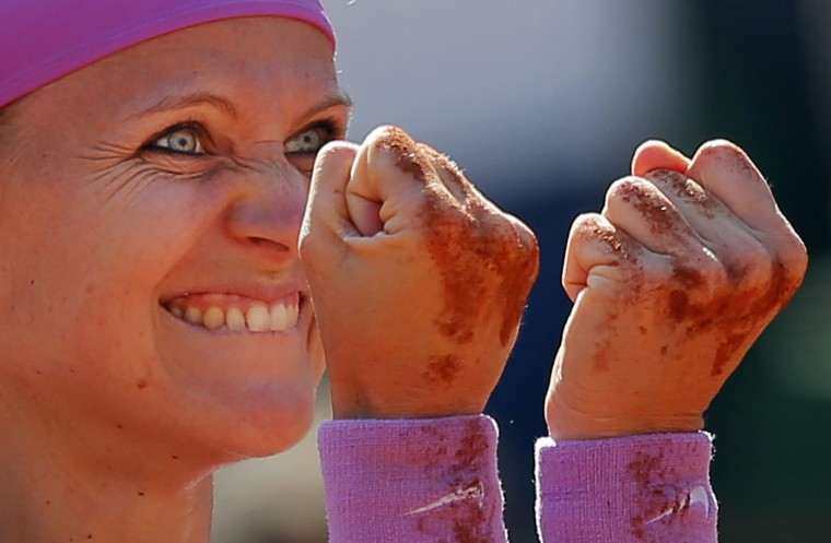 Lucie Safarova of the Czech Republic celebrates winning her semifinal match of the French Open tennis tournament against Serbia's Ana Ivanovic in two sets, 7-5, 7-5, at the Roland Garros stadium, in Paris, France, Thursday, June 4, 2015. (AP Photo/Francois Mori)