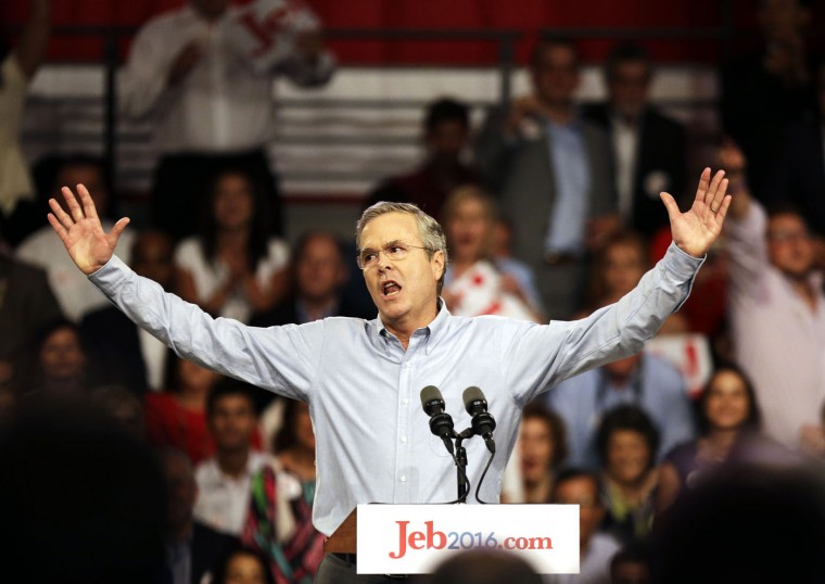 Former Florida Gov. Jeb Bush waves to the crowd as he formally joins the race for president with a speech at Miami Dade College, Monday, June 15, 2015, in Miami. (AP Photo/David Goldman)