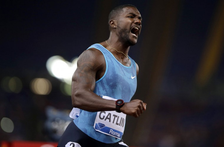 Justin Gatlin, of the United States, celebrates after winning the men's 100m event at the Golden Gala IAAF athletic meeting, in Rome's Olympic stadium, Thursday, June 4, 2015. Justin Gatlin came within 0.01 seconds of his world-leading time in the 100 meters, clocking 9.75 at the Golden Gala on Thursday. With the wind in his favor, Gatlin finished several strides ahead of the rest of the field then flexed his biceps for photographers in the finish area. (AP Photo/Andrew Medichini)