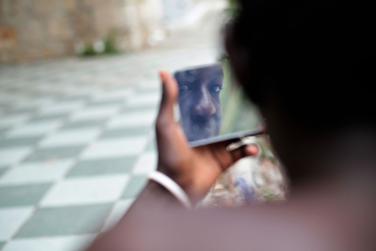 Ahmed Abraham, 22, from Sudan, shaves his face, at the Franco-Italian border in Ventimiglia, Italy, Monday, June 22, 2015. The European Union launched a naval operation Monday to try to stop human-traffickers from bringing migrants across the Mediterranean to Europe in unseaworthy boats, a lucrative and at times deadly practice. (AP Photo/Thibault Camus)