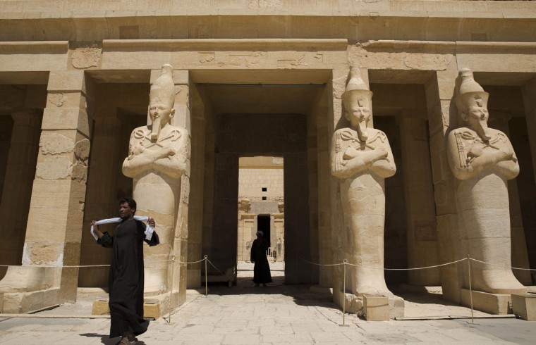 An Egyptian tourist guide waits for tourists in the Hatshepsut Temple in Deir el-Bahari on the west bank of the Nile River at Luxor, Egypt, Thursday, June 11, 2015. Militants tried to attack the ancient temple of Karnak in southern Egypt on Wednesday, with a suicide bomber blowing himself up and two gunmen battling police. No sightseers were hurt in the thwarted assault. (AP Photo/Hassan Ammar)