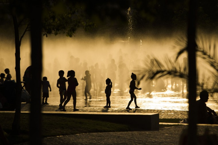Children play as they cool down in a fountain beside the Manzanares river in Madrid, Spain, Monday evening, June 29, 2015. Weather stations across Spain are warning people to take extra precautions as a heat wave engulfs much of the country, increasing the risk of wildfires. The country's meteorological agency says a mass of hot air originating in Africa is moving northwards, bringing with it until at least Monday temperatures reaching 40 Celsius (104 Fahrenheit). (AP Photo/Andres Kudacki)