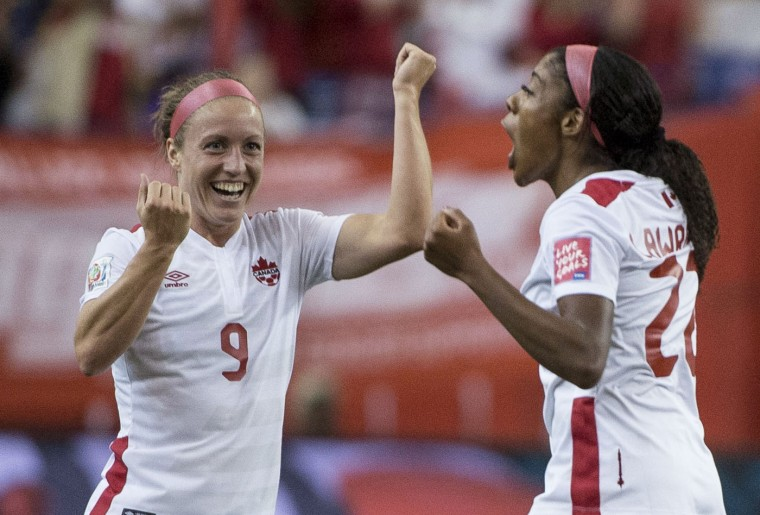 Canada midfielder Ashley Lawrence, right, celebrates her goal against the Netherlands with teammate Josee Belanger during the first half of a FIFA Women's World Cup soccer match Monday, June 15, 2015, in Montreal, Canada. (Paul Chiasson/The Canadian Press via AP)
