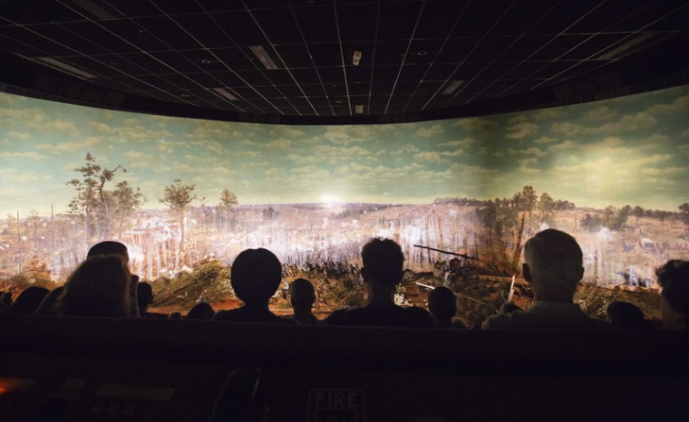 Visitors view the Atlanta Cyclorama, the colossal Civil War painting created about 130 years ago, on Tuesday in Atlanta. Cyclorama officials say Tuesday is the last day visitors can see the 15,000-square-foot oil painting in Grant Park before it leaves the building it has occupied since 1921 to move across town. After the Cyclorama closes late Tuesday afternoon, the painting will be prepared for its move to a new addition being constructed at the Atlanta History Center. The Cyclorama was painted by a group of German artists at the American Panorama Co. in Milwaukee in the mid-1880s. (David Goldman/AP)