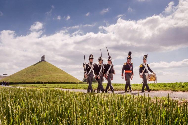 A few Battle of Waterloo re-enactors walk near the Lion's Mound during an historical walk for journalists in Waterloo, Belgium, on Tuesday. On June 19 and 20, the bicentenary of the battle will be commemorated with a reconstruction with 5,000 re-enactors. (Geert Vanden Wijngaert/AP)