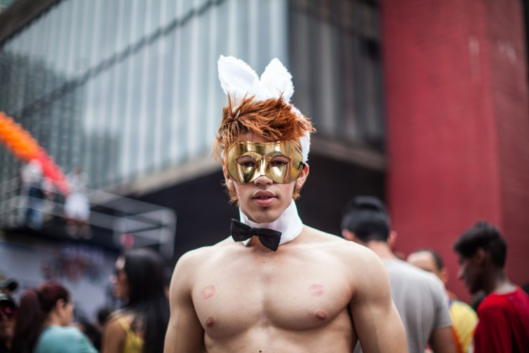 A reveler poses for a photo during the annual Gay Pride Parade in Sao Paulo, Brazil, Sunday, June 7, 2015. Hundreds of thousands gather every year on skyscraper-lined Avenida Paulista in Sao Paulo for one of the world's largest gay pride parades. (AP Photo/Andre Lessa)