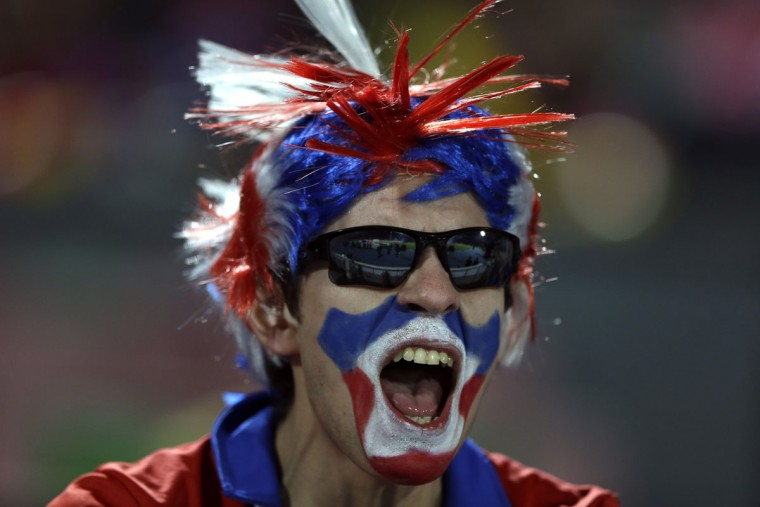 An Chilean fan cheers during the opening ceremony of the Copa America soccer tournament at the National Stadium in Santiago, Chile, Thursday, June 11, 2015.(AP Photo/Ricardo Mazalan)