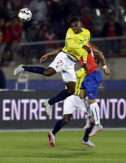 Ecuador's Gabriel Achilier heads the ball during a Copa America Group 1 soccer match at the National Stadium in Santiago, Chile, Thursday, June 11, 2015.(AP Photo/Natacha Pisarenko)