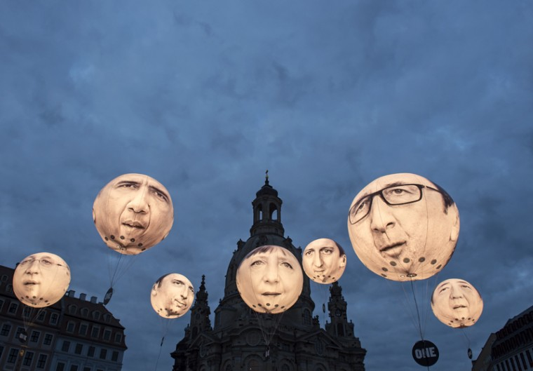 In this Wednesday file photo, activists of the international campaigning and advocacy organization ONE install illuminated balloons with portraits of the G7 heads of state in front of the Frauenkirche cathedral (Church of Our Lady) prior the G7 Finance Ministers meeting in Dresden, eastern Germany. The G7 Finance Ministers meeting was held in Dresden over the weekend. (Jens Meyer/AP)