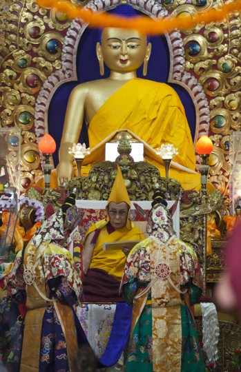 Tibetan spiritual leader the Dalai Lama wears a ceremonial hat during an official prayer ceremony to celebrate his 80th birthday in Dharmsala, India, Sunday, June 21, 2015. The Dalai Lama was born on July 6 according to the Gregorian calendar but his birthday this year falls on June 21 according to the lunar calendar followed traditionally by Tibetans. (AP Photo/Ashwini Bhatia)