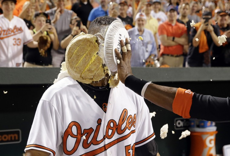August 2015: Baltimore Orioles' Henry Urrutia is hit in the face with a pie by teammate Adam Jones after a baseball game against the New York Mets, Wednesday, Aug. 19, 2015, in Baltimore. Urrutia hit a solo home run in the ninth to give Baltimore a 5-4 win. (AP Photo/Patrick Semansky)