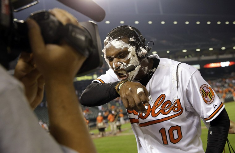 June 2015: Baltimore Orioles' Adam Jones reacts after being hit in the face with a pie by teammate Manny Machado during a post game television interview after a baseball game against the Boston Red Sox, Wednesday, June 10, 2015, in Baltimore. Baltimore won 5-2. (AP Photo/Patrick Semansky)