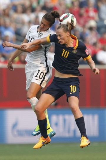 Australia's Emily van Egmond, right, and United States' Carli Lloyd go up for the ball during the first half of a FIFA Women's World Cup soccer match in Winnipeg, Manitoba, Monday, June 8, 2015. (John Woods/The Canadian Press via AP)
