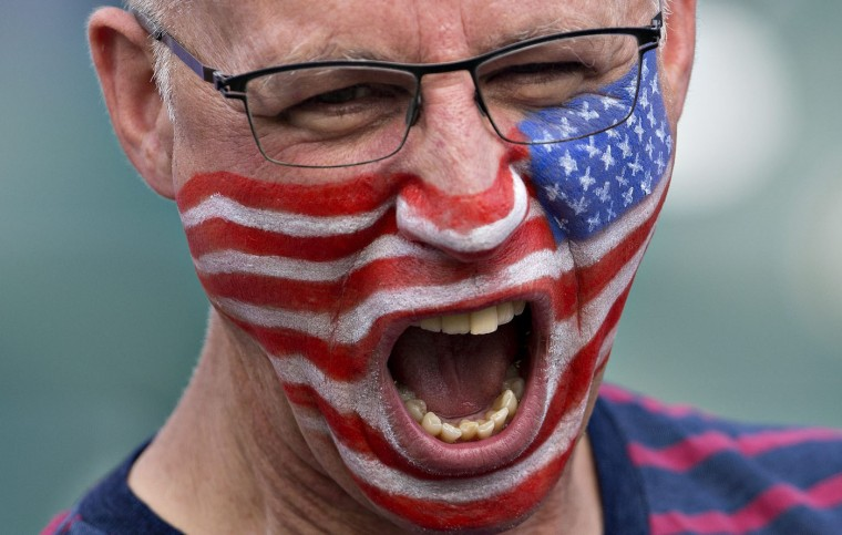 A United States fan cheers for his team before the start of FIFA Women's World Cup round of 16 action against Colombia in Edmonton, Alberta, Canada, Monday, June 22, 2015. (Jason Franson/The Canadian Press via AP)