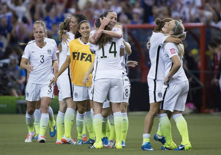 The U.S. teams celebrates after defeating Germany 2-0 in a semifinal in the Women's World Cup soccer tournament, Tuesday, June 30, 2015, in Montreal, Canada. (Graham Hughes/The Canadian Press via AP)
