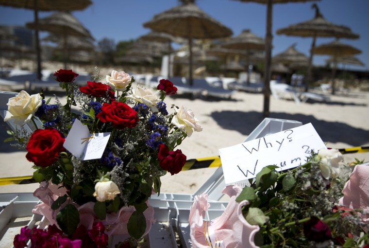 Flower bouquets are seen at the site of a shooting attack on the beach in front of the Riu Imperial Marhaba Hotel in Port el Kantaoui, on the outskirts of Sousse south of the capital Tunis. The Islamic State (IS) group claimed responsibility on June 27 for the massacre in the seaside resort that killed nearly 40 people, most of them British tourists, in the worst attack in the country's recent history. (Kenzo Tribouillard/AFP-Getty Images)