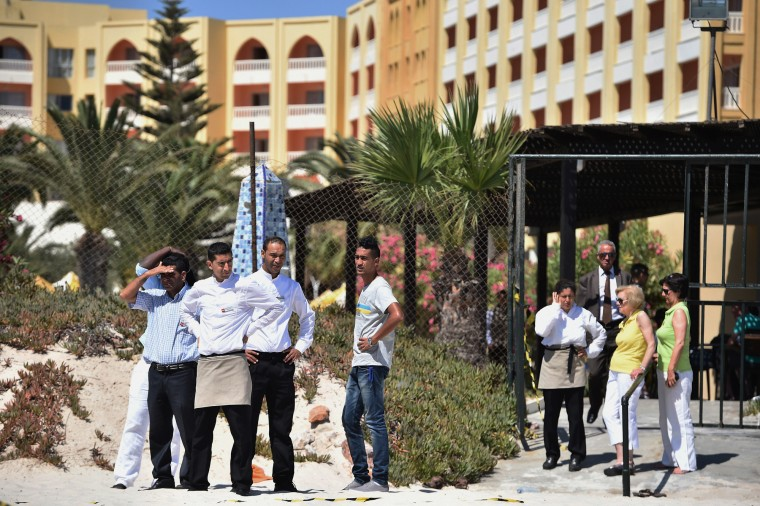 People view the scene at the beach next to the Imperial Marhaba Hotel where 38 people were killed yesterday in a terrorist attack in Souuse,Tunisia. Habib Essid Prime Minister of Tunisia announced a clampdown on security after the attack on a holiday resort. (Jeff J Mitchell/Getty Images)