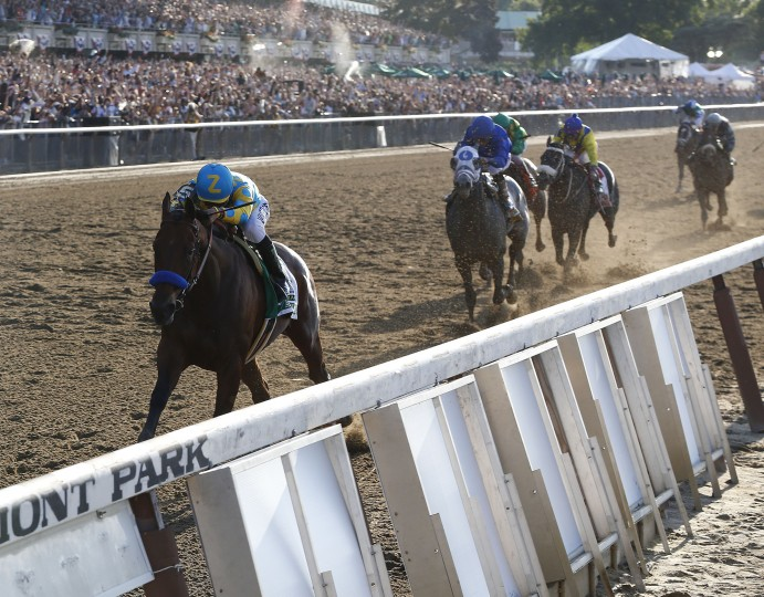 American Pharoah (5) with Victor Espinoza up leads the pack as he approaches the finish line during the 147th running of the Belmont Stakes horse race at Belmont Park, Saturday, June 6, 2015, in Elmont, N.Y. American Pharoah won to be the first horse to win the Triple Crown since Affirmed did it in 1978. (Julio Cortez/Associated Press)