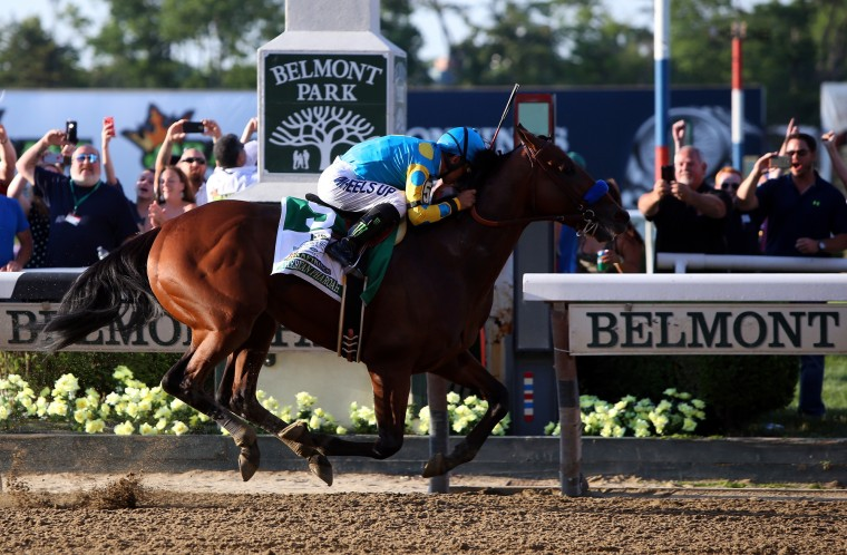 Victor Espinoza, celebrates atop American Pharoah #5, after winning the 147th running of the Belmont Stakes at Belmont Park on June 6, 2015 in Elmont, New York. With the wins American Pharoah becomes the first horse to win the Triple Crown in 37 years. (Travis Lindquist/Getty Images)