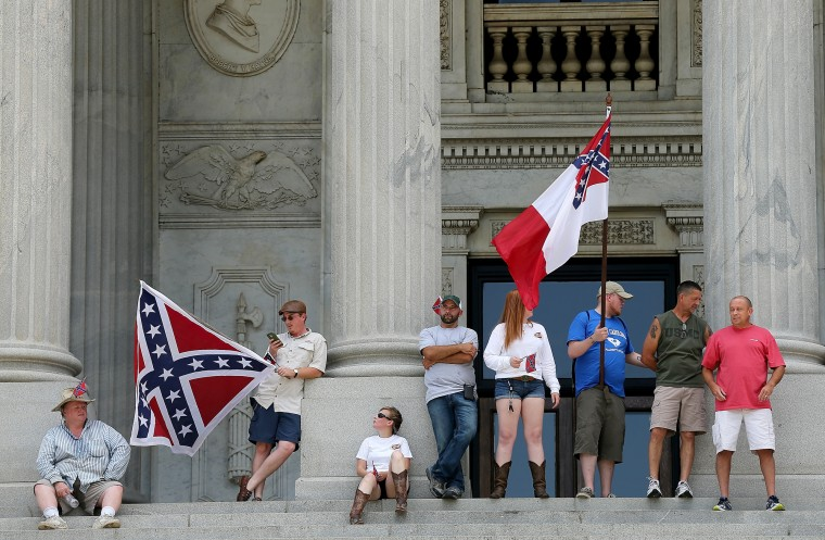 Demonstrators stand at the top of the steps of the South Carolina State House while calling for the Confederate flag to remain on the State House grounds in Columbia, South Carolina. Earlier in the week South Carolina Gov. Nikki Haley expressed support for removing the Confederate flag from the State House grounds in the wake of the nine murders at Mother Emanuel A.M.E. Church in Charleston, South Carolina. (Win McNamee/Getty Images)