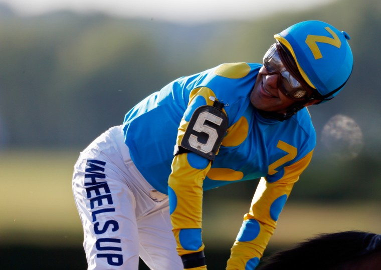 Victor Espinoza, celebrates atop American Pharoah #5, after winning the 147th running of the Belmont Stakes at Belmont Park on June 6, 2015 in Elmont, New York. With the wins American Pharoah becomes the first horse to win the Triple Crown in 37 years. (Scott Halleran/Getty Images)
