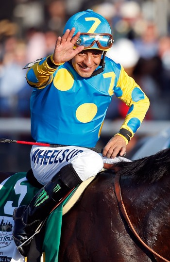 Victor Espinoza, celebrates atop American Pharoah #5, after winning the 147th running of the Belmont Stakes at Belmont Park on June 6, 2015 in Elmont, New York. With the wins American Pharoah becomes the first horse to win the Triple Crown in 37 years. (Rob Carr/Getty Images)