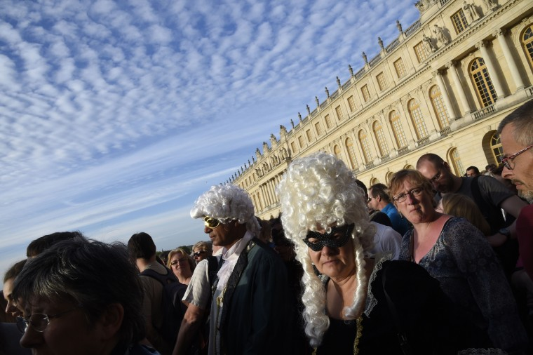 A ball at Versailles castle near Paris is part of the celebration surrounding the 300th anniversary of King Louis XIV's death. (Dominique Faget/AFP-Getty Images)