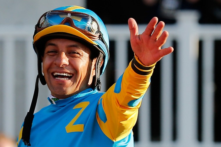 Victor Espinoza, celebrates atop American Pharoah #5, in the winner's circle after winning the 147th running of the Belmont Stakes at Belmont Park on June 6, 2015 in Elmont, New York. With the wins American Pharoah becomes the first horse to win the Triple Crown in 37 years. (Rob Carr/Getty Images)