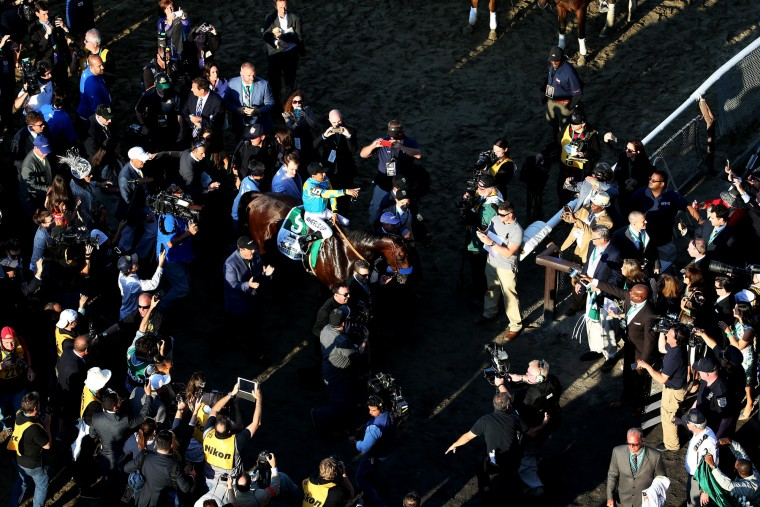 Victor Espinoza, celebrates atop American Pharoah #5, in the winner's circle after winning the 147th running of the Belmont Stakes at Belmont Park on June 6, 2015 in Elmont, New York. With the wins American Pharoah becomes the first horse to win the Triple Crown in 37 years. (Mike Stobe/Getty Images)