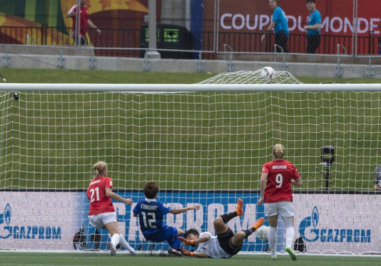 Norway's Ada Hegerberg scores past Thailand's goalkeeper Warapom Boonsing and Rattikan Thongsombut during a Group B match at the 2015 FIFA Women's World Cup at Landsdowne Stadium in Ottawa on June 7, 2015. (NICHOLAS KAMM/AFP/Getty Images)