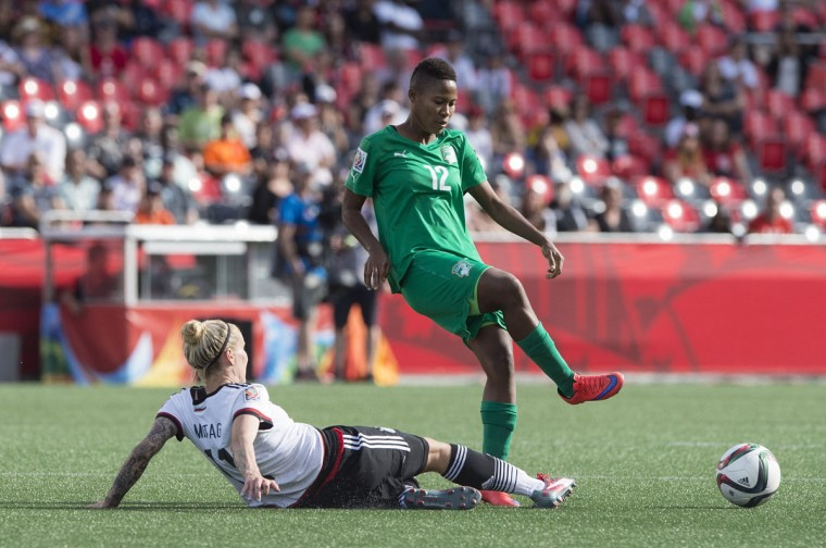 Germany's Anja Mittag tackles Ivory Coast's Ida Guehai during a Group B match at the 2015 FIFA Women's World Cup at Landsdowne Stadium in Ottawa on June 7, 2015. (NICHOLAS KAMM/AFP/Getty Images)
