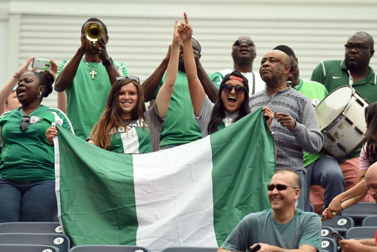 Nigeria fans cheer before the Group D match of the 2015 FIFA Women's World Cup between Nigeria and Sweden at the Winnipeg Stadium on June 8, 2015, in Winnipeg, Manitoba. (JEWEL SAMAD/AFP/Getty Images)