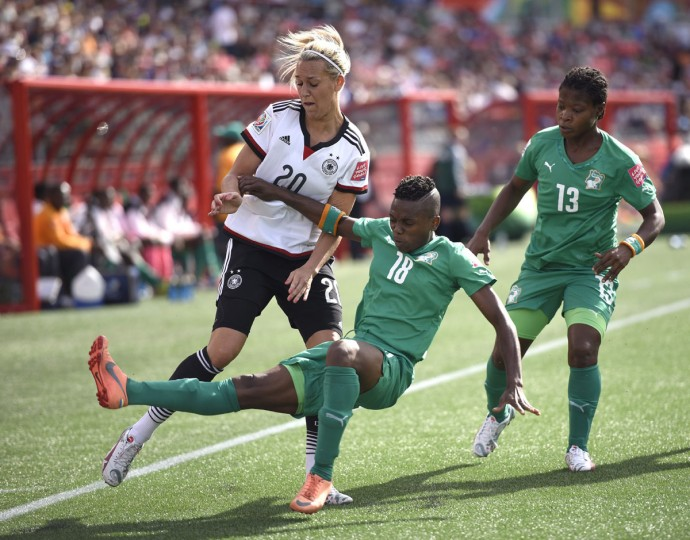 Ivory Coast's Binta Diakite tries to keep Germany's Lena Goessling from the ball in the corner during second half FIFA Women's World Cup soccer action in Ottawa, Ontario on Sunday, June 7, 2015. (Justin Tang/The Canadian Press via AP)