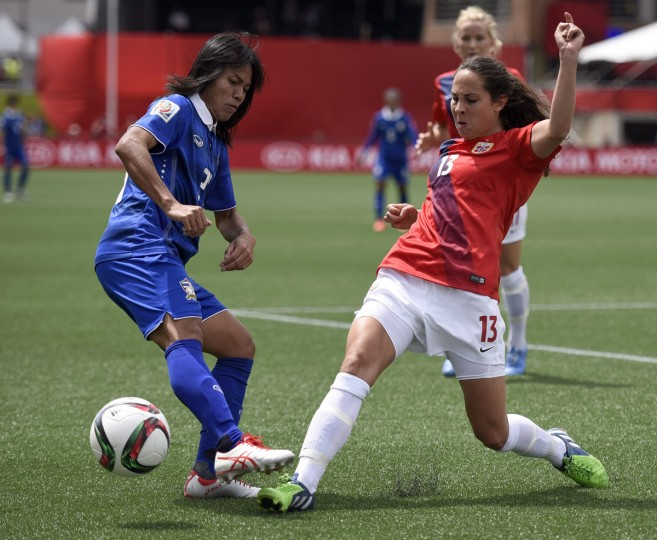 Norway's Ingrid Moe Wold tries to keep Thailand's Kanjana Sung-Ngoen away from the ball during second half FIFA Women's World Cup soccer action in Ottawa, Ontario, Sunday, June 7, 2015. Norway defeated Thailand 4-0. (Justin Tang/The Canadian Press via AP)
