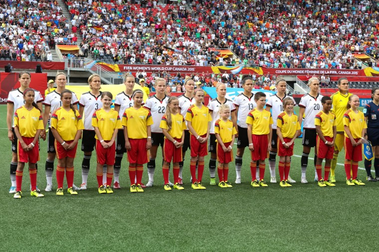Team Germany stands with minor league soccer players prior to kickoff at the FIFA Women's World Cup Canada 2015 Group B match between Germany and Cote d'Ivoire at Lansdowne Stadium on June 7, 2015 in Ottawa, Canada. (Photo by Andre Ringuette/Getty Images)