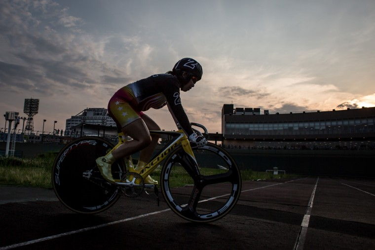 A rider enters the velodrome ahead of her race during Keirin races at Kawasaki Velodrome on July 11, 2015 in Kawasaki, Japan. (Photo by Chris McGrath/Getty Images)