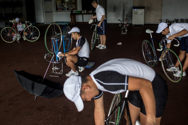 Keirin students prepare their bikes ahead of training at the Nihon Keirin Gakkou (Japan Keirin School) on July 8, 2015 in Izu, Japan. (Photo by Chris McGrath/Getty Images)