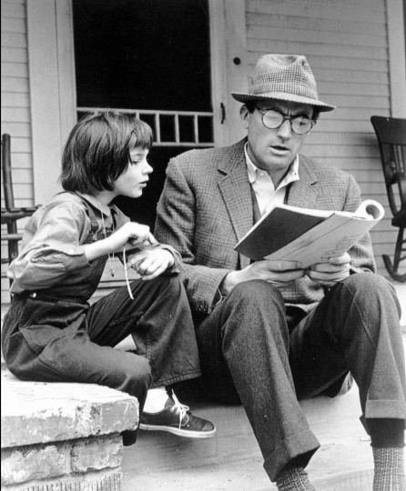 """July 11, 1960: Harper Lee's novel """"To Kill a Mockingbird"""" is released. In 1962, it was made into a movie starring Gregory Peck, left, and 9-year-old Mary Badham, who are seen here studying their lines on the set in this file photo."""