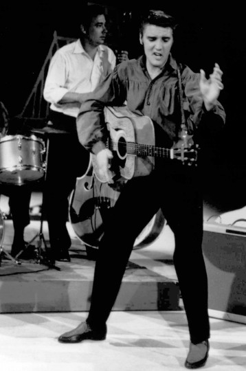 """July 7, 1954: Elvis Presley, seen here performing on the """"Ed Sullivan Show,"""" debuted his song """"That's All Right"""" on WHBQ radio in Memphis, Tenn. (AP file photo)"""