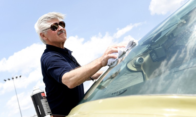 Derward Brooks, of North Laurel, wipes off the front windshield of the single-engine Cessna airplane he will fly on a mission for Angel Flight East on Tuesday, June 9, 2015 at BWI Airport. Angel Flight East relies on volunteers like Brooks to fly patients with cancer and other medical conditions from their homes to places where they can get treatment. (Jon Sham/Baltimore Sun)