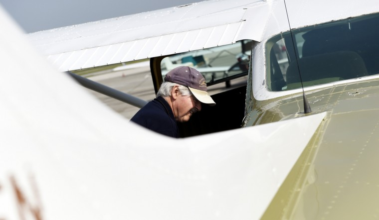 Derward Brooks, of North Laurel, checks over the plan he'll fly the next day on a mission for Angel Flight East on Tuesday, June 9, 2015 at BWI Airport. The mission, which took place on Wednesday, June 10, involved flying from Baltimore to Philadelphia, then to Lynchburg, Va., before coming back to BWI. (Jon Sham/Baltimore Sun)