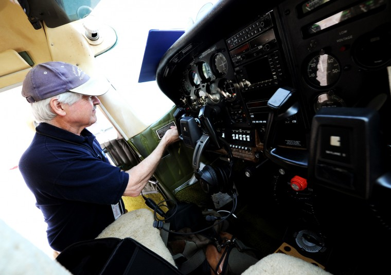 Derward Brooks, of North Laurel, checks prepares the cockpit of the single-engine Cessna plane he will fly for Angel Flight East on Wednesday, June 10, 2015 at BWI Airport. Brooks has been flying since the late 1990s and has about 600 hours of flight time. He has done several Angel Flight missions over the past few years. (Jon Sham/Baltimore Sun)