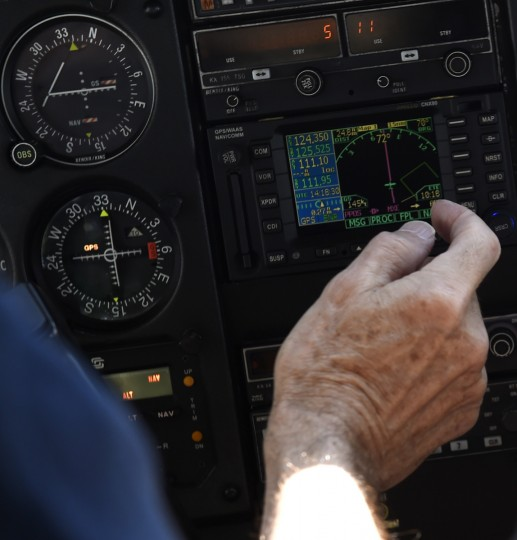 Pilot Derward Brooks checks the GPS as he and co-pilot Larry Esser prepare for a descent into Philadelphia on Wednesday, June 10, 2015. The pair volunteered to fly a patient part of the way back to her North Carolina home as part of the Angel Flight network. (Jon Sham/Baltimore Sun)
