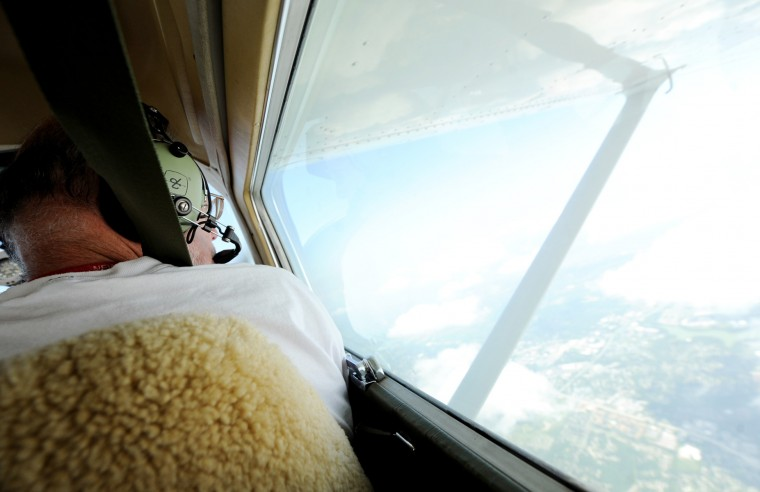 Co-pilot Larry Esser, of Glen Burnie, looks out the window of the single-engine Cessna as he and pilot Derward Brooks follow a course from Philadelphia to Lynchburg, Va., transporting Marleene DeNardo part of the way to her home in North Carolina on an Angel Flight, Wednesday, June 10, 2015. (Jon Sham/Baltimore Sun)