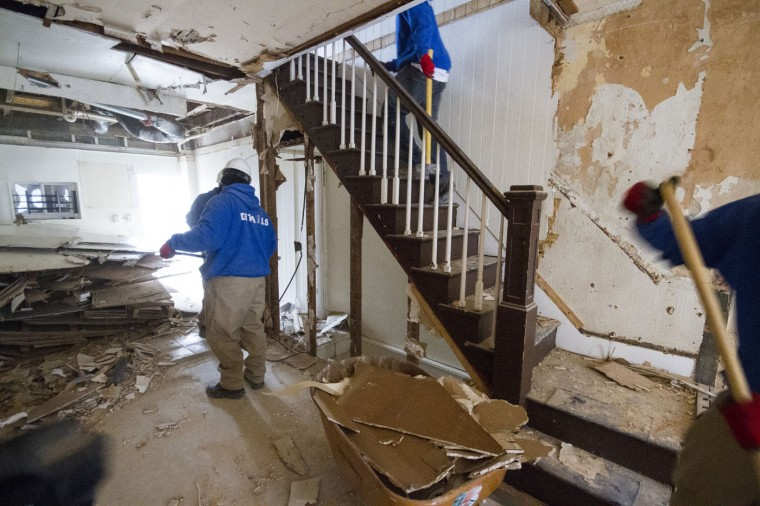 Details employees gut and clear out the homes in the 900 block of N. Port Street prior to beginning their deconstruction brick by brick. (Kalani Gordon, Baltimore Sun)
