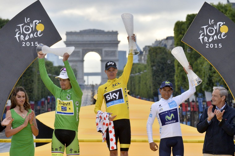 Great Britain's Christopher Froome (C), wearing the overall leader's yellow jersey, Slovakia's Peter Sagan (2nd L), wearing the best sprinter's green jersey and Colombia's Nairo Quintana (2nd R), wearing the best young's white jersey pose on the podium on the Champs-Elysees avenue, at the end of the 109,5 km twenty-first and last stage of the 102nd edition of the Tour de France cycling race on July 26, 2015, between Sevres and Paris. Stephanie Mantey/AFP