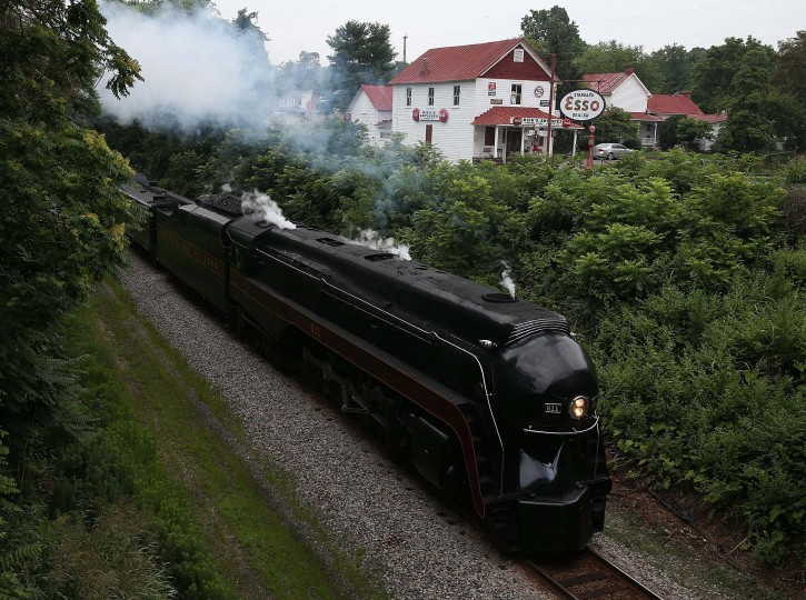 FOREST, VA - JULY 03: The recently restored former Norfolk and Western Railway J class steam locomotive 611 passes by during an excursion July 3, 2015 in Forest, Virginia. The 611 was originally retired and replaced by diesel locomotives in 1959 and now is running excursions on a limited schedule. (Photo by Mark Wilson/Getty Images)