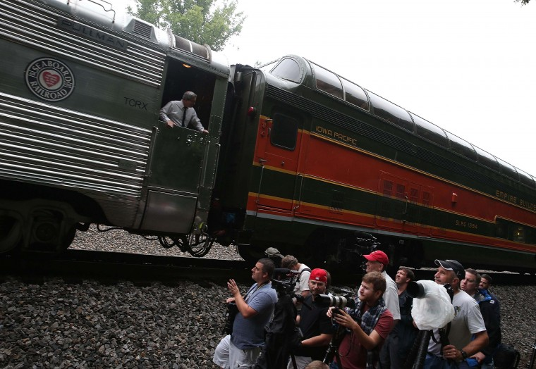 ROANOKE, VA - JULY 03: Amateure photographers watch as the recently restored former Norfolk and Western Railway J class steam locomotive 611 passes by during an excursion July 3, 2015 in Roanoke, Virginia. The 611 was originally retired and replaced by diesel locomotives in 1959 and now is running excursions on a limited schedule. (Photo by Mark Wilson/Getty Images)
