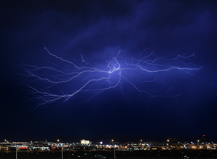 Lightning strikes during a thunderstorm on Tuesday in Las Vegas. The monsoon storm dropped heavy rain and hail in parts of the valley causing street flooding and power outages. (Ethan Miller/Getty Images)