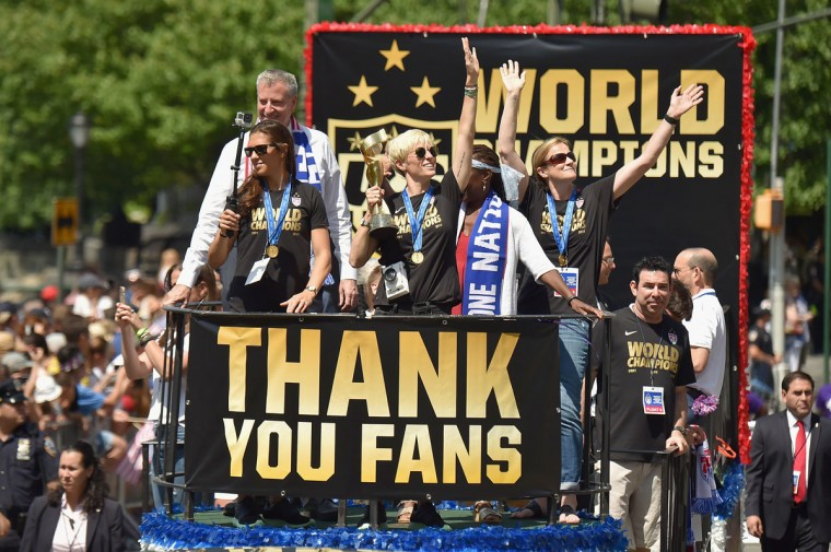 Soccer players Carli Lloyd and Megan Rapinoe in the New York City Ticker Tape Parade for World Cup Champions U.S. Women's Soccer National Team on July 10, 2015 in New York City. (Photo by Michael Loccisano/Getty Images)